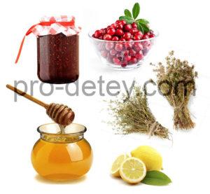 мед, лимон, сухие травы, банка варенья, миска с клюквой